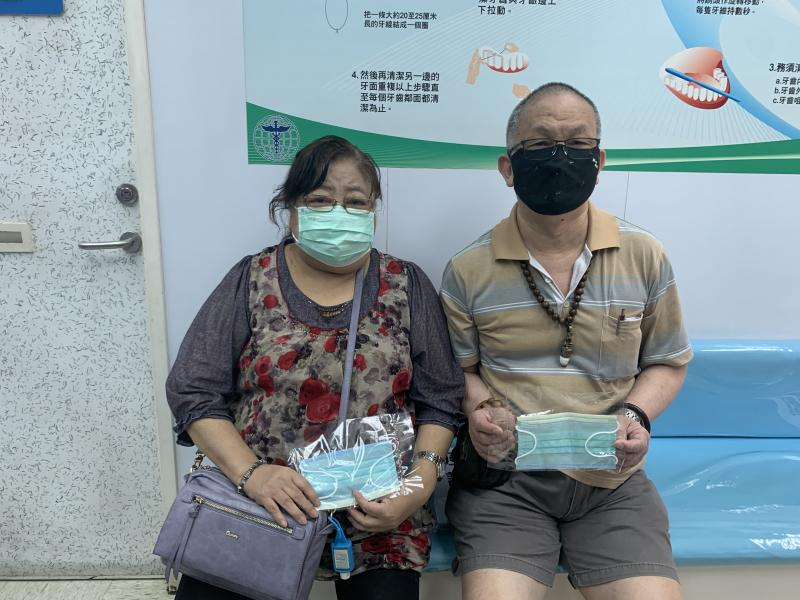Giving out face masks to patients